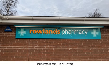 St Helens, Merseyside. UK. 03/17/2020  Rowlands Pharmacy (NUMARK) signs on the outside of the pharmacy.