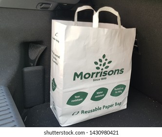 St Helens, Merseyside. UK 06/22/2019 A paper environmentally friendly Morrison's carrier bag in the boot of a car.