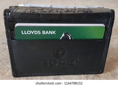 St Helens, UK August 26 2018 Males leather wallet showing a Lloyds bank card
