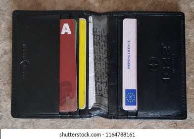 St Helens, UK August 26 2018 Males leather wallet showing a UK photo card drivers license