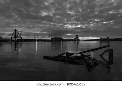 St Helier harbour, Jersey, U.K. B&W image of a calm high tide at sunset in Autumn.