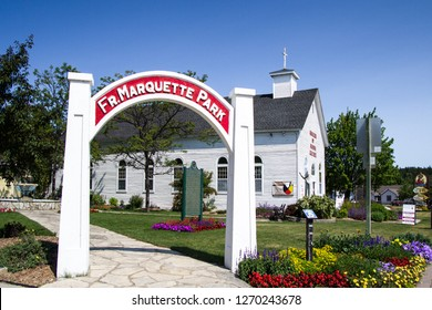 St. Ignace, Michigan, USA - July 8, 2015: Park dedicated to Jesuit Missionary priest Father Marquette and the Museum of Ojibwa culture in downtown St. Ignace, Michigan.