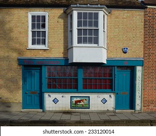 ST IVES, CAMBRIDGESHIRE, ENGLAND - NOVEMBER 24, 2014: Built in 1904/5 colourful Decorated tiles front the old butchers shop.