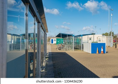 St Ives, Cambridgeshire, UK - Circa March 2019: View from a Bus Shelter located at a Park and Ride centre. Detail of the glass windows and distant cycle racks together with CCTV are visible.