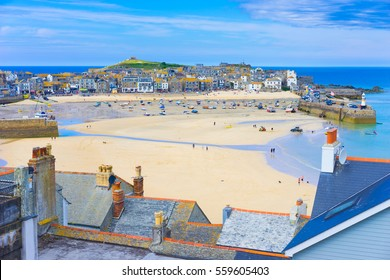 St. Ives, Cornwall, England, UK in the summer. View of the harbor at low tide.
