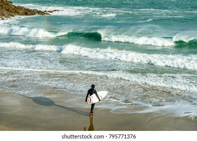 St Ives, Cornwall, UK, 16/01/2018. Editorial: Unknown surfers in the swell.
