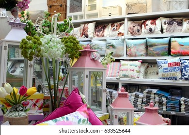 St Ives, Cornwall, UK - April 3 2017: Colourful homeware and linen items for sale on shelves in a fancy goods store