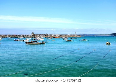St. Ives, Cornwall, UK. June 29, 2019. Competitors returning into the harbor in the racing rowing Gigs after a competition at St. Ives in Cornwall, UK.