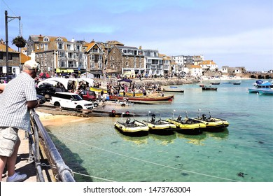 St. Ives, Cornwall, UK. June 29, 2019. Competitors and spectators in preparation for the Gig racing in the harbor at St. Ives in Cornwall, UK.