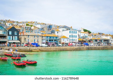 St. Ives, England - July 19, 2018: View of waterfront in St Ives, a major tourist attraction and surfing spot in Cornwall, England