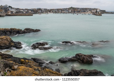 ST IVES, ENGLAND - JUNE 18: The tide swirls in as evening draws in, in St Ives, Cornwall. In St Ives, Cornwall, England. On 18th June 2018.