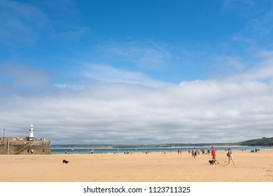 ST IVES, ENGLAND - JUNE 18: Golden sands and blue sky on a hot Summer day in St Ives, England. In St Ives, Cornwall, England. On 18th June 2018.
