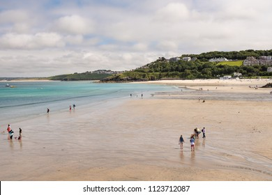 ST IVES, ENGLAND - JUNE 18: Families enjoying Porthminster Beach, St Ives, on a Summer day. In St Ives, Cornwall, England. On 18th June 2018.