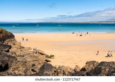 ST IVES, ENGLAND - JUNE 18: People enjoying Porthminster Beach, St Ives, on a hot, sunny, summer day. In St Ives, Cornwall, England. On 18th June 2018.