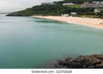 ST IVES, ENGLAND - JUNE 18: The tide washes in as evening draws in, in St Ives, Cornwall. In St Ives, Cornwall, England. On 18th June 2018.