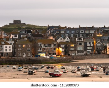 ST IVES, ENGLAND - JUNE 19: St Nicholas Chapel, which sits above the Cornish fishing village of St Ives, in England. In St Ives, Cornwall, England. On 19th June 2018.
