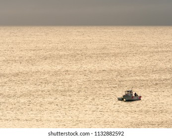 ST IVES, ENGLAND - JUNE 19: A fisherman setting gear off the coast of St Ives. In St Ives, Cornwall, England. On 19th June 2018.
