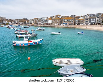 ST IVES, ENGLAND - JUNE 19: The sea looking a beautiful blue/green in St Ives harbour on a sunny Summer day. In St Ives, Cornwall, England. On 19th June 2018.