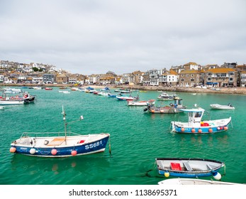 ST IVES, ENGLAND - JUNE 19: Fishing boats moored in St Ives harbour, on a Summer day, in Cornwall. In St Ives, Cornwall, England. On 19th June 2018.