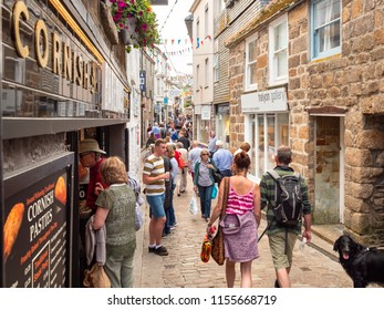 ST IVES, ENGLAND - JUNE 19: Fore Street, St Ives - a traditional Cornish shopping street. In St Ives, England. On 19th June 2018.