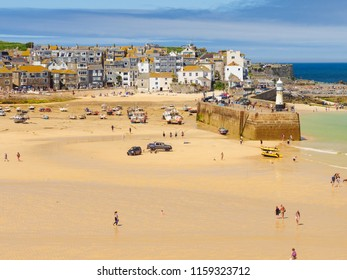 ST IVES, ENGLAND - JUNE 19: People enjoying the British Summer heatwave of 2018 on St Ives beach. In St Ives, Cornwall, England. On 19th June 2018.