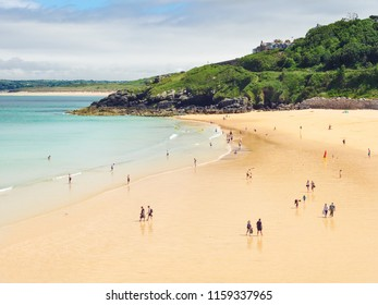 ST IVES, ENGLAND - JUNE 19: People on Porthminster Beach, St Ives, during the Summer heatwave of 2018. In St Ives, Cornwall, England. On 19th June 2018.