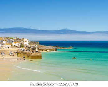 ST IVES, ENGLAND - JUNE 19: The beautiful, clear water of the sea at St Ives in Cornwall. In St Ives, England. On 19th June 2018.