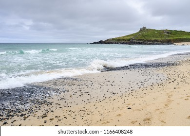 ST IVES, ENGLAND - JUNE 20: Rough sea crashing on the shore at Porthmeor beach. In St Ives, Cornwall, England. On 20th June 2018.