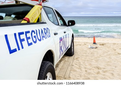 ST IVES, ENGLAND - JUNE 20: White RNLI Lifeguard truck on Porthmeor beach. In St Ives, Cornwall, England. On 20th June 2018.