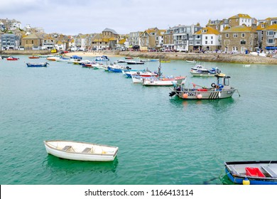 ST IVES, ENGLAND - JUNE 20: A row of fishing boats moored in St Ives harbour, Cornwall. In St Ives, Cornwall, England. On 20th June 2018.