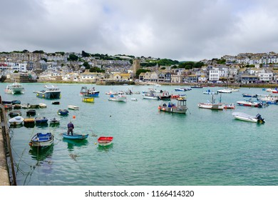 ST IVES, ENGLAND - JUNE 20: Fishing boats moored within St Ives harbour. In St Ives, Cornwall, England. On 20th June 2018.