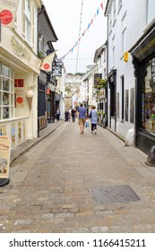 ST IVES, ENGLAND - JUNE 20: Fore Street - a traditional Cornish shopping street in St Ives. In St Ives, Cornwall, England. On 20th June 2018.
