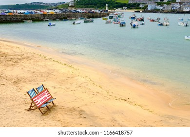 ST IVES, ENGLAND - JUNE 20: 'Deckchairs For Hire' sign on beach. In St Ives, Cornwall, England. On 20th June 2018.