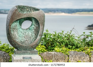 St. Ives, England -  June 2018 : Epidauros II - Barbara Hepworth sculpture in a garden above the beach and bay, Cornwall, UK