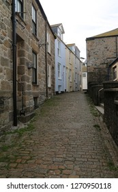 St Ives, UK, cobble street with stone buildings