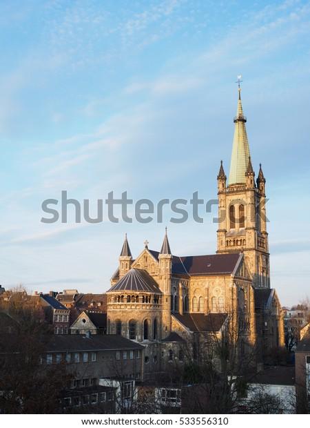 St. Jakob church illuminated by the morning sun. Aachen, Germany