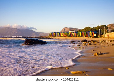 St James beach with its colorful bathing boxes in Cape Town, South Africa.