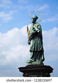 St. John of Nepomuk statue on the Charles Bridge, Prague. May, 2018.
