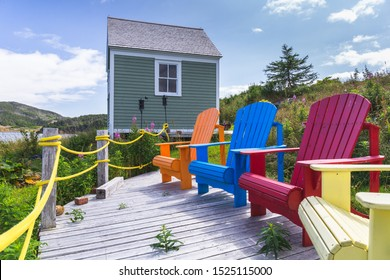 [St. John, Newfoundland - August 2019] Wooden colorful dechchairs in front of the lake, Newfoundland, Canada