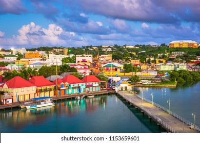 St. John's, Antigua and Barbuda cityscape over Redcliffe Quay at dusk.