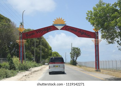 "ST. JOHN'S, ANTIGUA AND BARBUDA - JUNE 14, 2018: Sign "" Bon Voyage, Come Again"" near airport in Antigua. Antigua is one of the 2 major islands that make up the Caribbean nation of Antigua and Barbuda"