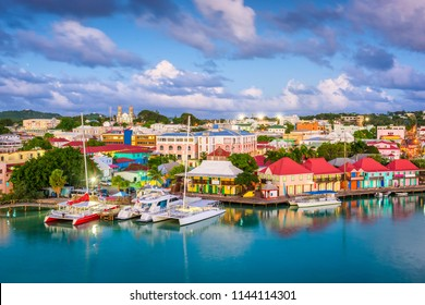 St. John's, Antigua and Barbuda town skyline on Redcliffe Quay at dusk.