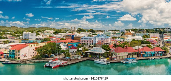 St johns, Antigua - March 05, 2016: city and sea port on cloudy blue sky. Summer vacation on tropical island. Travelling and wanderlust.