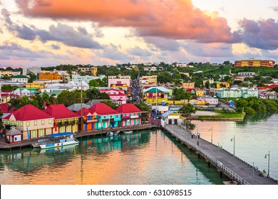 St. John's, Antigua port and skyline at dusk.