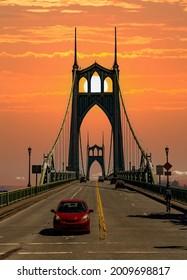 The St Johns bridge over the Willamette River at sunrise in Portland Oregon
