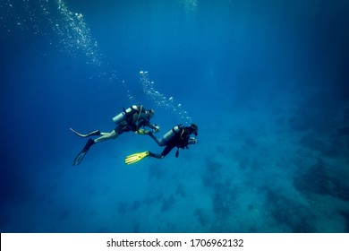 St John's Caves, Red Sea, Egypt - Aug 2016: Divers descend on the reef