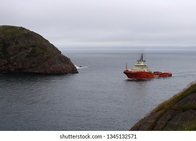 St. John's, Newfoundland, Canada - 07/16/2006: A commercial ship entering city harbor