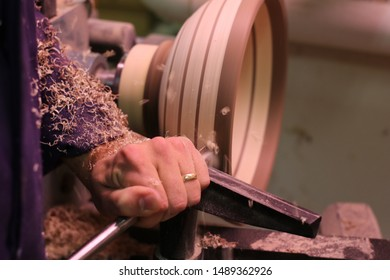 ST. JOHN'S, NEWFOUNDLAND / CANADA - NOVEMBER 10 2018: Woodworker at Work, Wood-turning a new bowl!