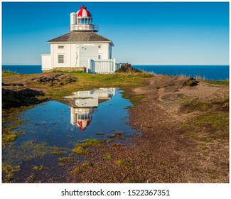 St John's, Newfoundland / Canada - September 14, 2019: The oldest working lighthouse in Newfoundland stands atop the seaside cliffs at Cape Spear near the easternmost point in North America