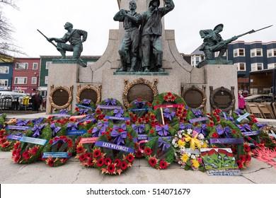 St John's Newfoundland/ Canada-November 11: Remembrance day ceremony, St John's Cenotaph on November 11, 2016. Wreaths left on St John's Newfoundland cenotaph